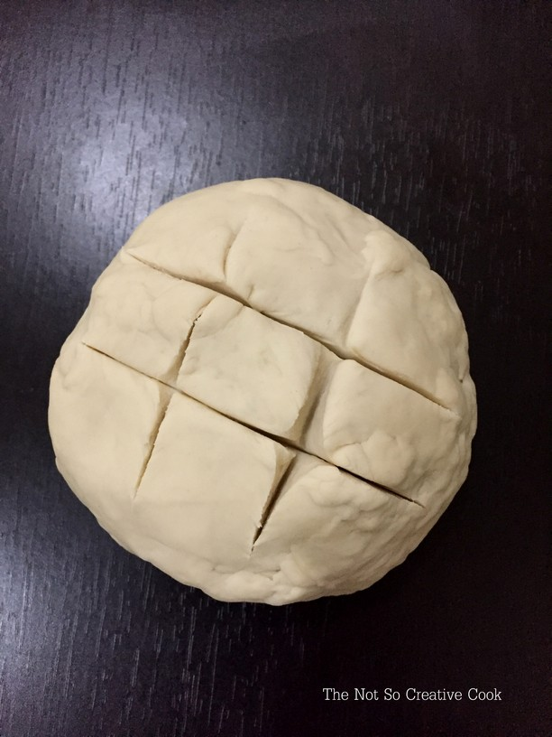 The dough slashed in tic-tac-toe pattern